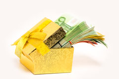 Gift box for savings full of euro banknotes money cash. Financial success debt free concept. Stock Photos