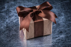 Gift box on scratched metallic background holidays concept Royalty Free Stock Photos