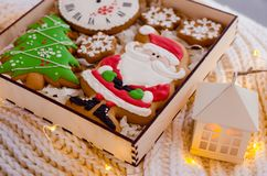 Gift box with a set of New Year gingerbread. The set includes Santa Claus, snowflakes, a Christmas tree and a clock. A row is a figure of a small decorative Royalty Free Stock Photography