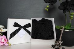 Gift box with a sexy lingerie. Flowers and present for the women. Festive underwear gift with black orchid for a lady Royalty Free Stock Image