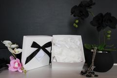 Gift box with a sexy lingerie. Flowers and present for the women. Festive underwear gift with black orchid for a lady Royalty Free Stock Photo