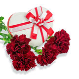 Gift Box in Shape of Heart and Bouquet from Carnations. Stock Photo