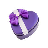 Gift box shape heart with a bow Stock Photography