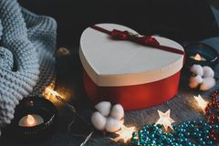 Cozy frosted photo with a red heart-shaped gift box stock photography