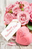 Gift box in the shape of hearts and pink roses with label Stock Photo