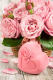 Gift box in the shape of hearts and pink roses Royalty Free Stock Images
