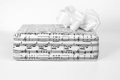 A gift box with sheet music Royalty Free Stock Image