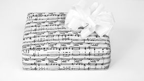 A gift box with sheet music Royalty Free Stock Photography