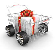 Gift box, shopping basket and wheels Stock Photography