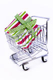 Gift box in shopping cart. Gift box in the shopping cart Royalty Free Stock Image