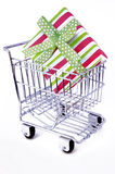 Gift box in shopping cart. Gift box in the shopping cart Royalty Free Stock Photography