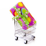 Gift box in shopping cart. Gift box in the shopping cart Stock Image