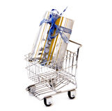 Gift box in shopping cart. Isolated Stock Photos