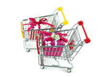 Gift box with shopping carts Stock Image