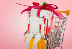 Gift box with shopping carts Stock Images