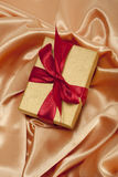 Gift box on silk background Stock Photography
