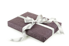 Gift box with silver bow isolated on white background Royalty Free Stock Photo