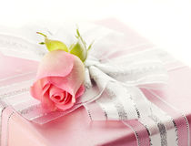 Gift box with a silver bow and rose Royalty Free Stock Photo