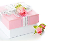 Gift box with a silver bow and roses Stock Image