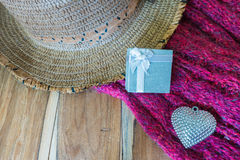 Gift box, silver heart, scarve, hat on wooden background decorat Royalty Free Stock Photos