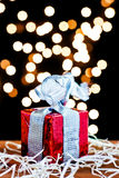 Gift box and silver ribbon. Gift box and light bokeh background Stock Image