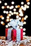Gift box and silver ribbon Stock Image