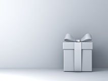 Gift box with silver ribbon bow and empty white wall background abstract Stock Image
