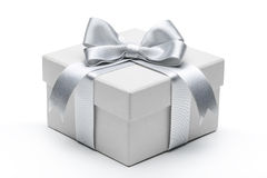 Gift box with silver ribbon bow Stock Photography