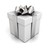 Gift box with silver ribbon bow on white Stock Photography