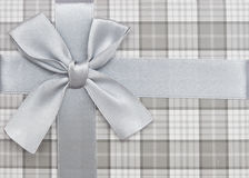 Gift box with silver ribbon and bow Stock Image