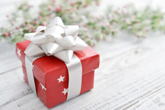 Gift box with silver ribbon. On a wooden background closeup Royalty Free Stock Images