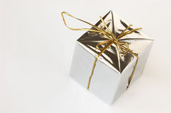 Gift box in silver wrapper Stock Photos
