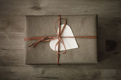 Gift Box with Simple Wrapping and Heart Shaped Label stock photography