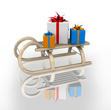Gift box in sled Stock Images