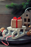 Gift box on sled Royalty Free Stock Photos