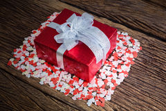 Gift box with small hearts Royalty Free Stock Images