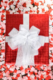 Gift box with small hearts Stock Images