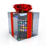 Gift box with smart-phone. On the white background Royalty Free Stock Photography