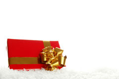 Gift Box in the Snow Stock Image