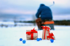 Gift box on the snow bow landscape Stock Image
