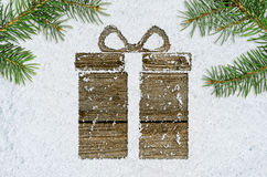 Gift box on snow Royalty Free Stock Photo