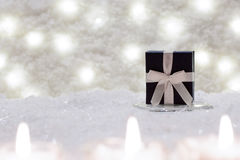 Gift box is in the snow. Stock Image