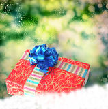 Gift box on a snow Royalty Free Stock Image