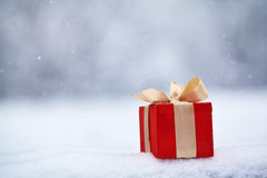 Gift box in the snow outdoors Royalty Free Stock Photography