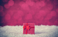 Gift box on snow Stock Images