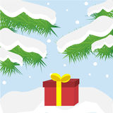 Gift box on snowdrift in forest. Red gift with yellow ribbon in snowdrift Stock Photo