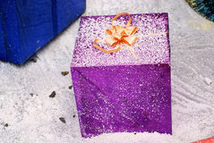 Gift box in snowfield Stock Images