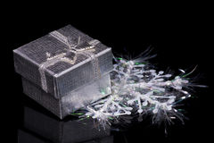 Gift box and snowflake Stock Image