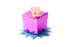 Gift box on snowflake Royalty Free Stock Image
