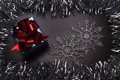 Gift box with snowflakes on wooden background Royalty Free Stock Photography
